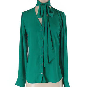 Green blouse with tie neck.